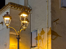 Streetlamps near a Historic Building in Grado Royalty Free Stock Image