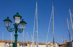 Streetlamps and Sailboat Masts Royalty Free Stock Photography