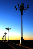 Streetlight. The evening sky blue river street lamp silhouette Royalty Free Stock Photo