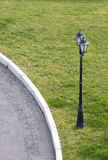 Streetlight. On the lawn at the edge of the road Royalty Free Stock Images