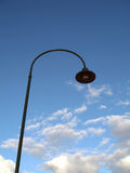 Streetlight. Single streetlight against blue sky stock photo