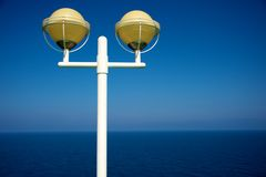 Streetlight against blue sky Royalty Free Stock Photos