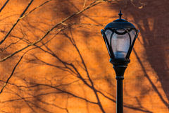 Streetlight on the background of brick wall Stock Images