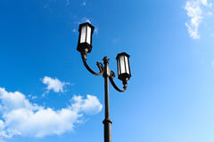 Streetlight. On blue sky Royalty Free Stock Images