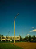 Streetlight on clean sky. One streetlight on foreground and fout on background royalty free stock photo