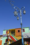 Streetlight with the colorful houses in Caminito. Royalty Free Stock Image