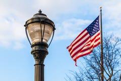 Streetlight and flag of USA Royalty Free Stock Photos