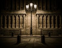 Streetlight in front of old building Stock Images
