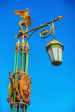 Streetlight with a gilded two-headed eagle in St. Petersburg. Street lamp with a gilded double-headed eagle and shield in Saint-Petersburg, Russia Stock Image