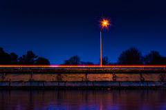 Streetlight and highway at night, in Kent Island, Maryland. Royalty Free Stock Images