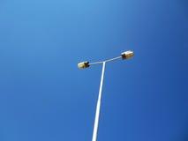 Streetlight. Illustration on blue sky. Streetlight isolated on blue sky,Streetlight with two hands Stock Image