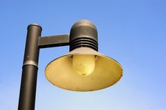 Streetlight isolated in sunny day. Royalty Free Stock Photo