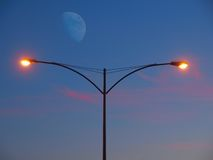 Streetlight at the moon rise Stock Photography