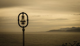 Streetlight over the sea. Streetlight in the village of Lastres, Spain Royalty Free Stock Photos