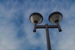 Streetlight post on blue sky. Background Royalty Free Stock Image