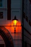 Streetlight in Prague. Burning streetlight at night on the building in Prague, the Czech Republic royalty free stock photo