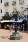 Streetlight and shops, Torremolinos. Royalty Free Stock Photo