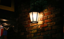 Streetlight of the wall of the brick. Night view of the light of the streetlight of the wall of the brick Stock Photo