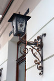 Streetlight on wall. Vintage street lamp on the wall Stock Photo