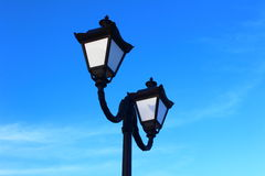 Streetlights. Against the blue sky visible streetlights for street lighting Royalty Free Stock Images