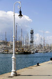 Streetlights in Barcelona harbor Royalty Free Stock Photo
