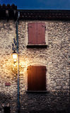 Streetlights and closed windows at the eveing in france village Stock Photography