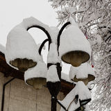 Streetlights covered with a thick snow layer Stock Images