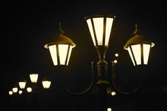Streetlights Road Lamps Stock Photograph. The beautiful streetlights lamp bulbs captured in the night time from a pleasant tourist spot stock background Stock Image