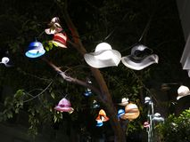 Streetlights made out of hats and bonnets in Athens, Greece stock photo