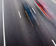Streetracing. Cars on a road with motion blur effect Royalty Free Stock Photos