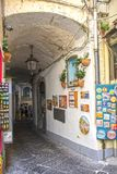 Streets of Amalfi. At Amalfi - Italy - On July 2018 - Lively street in the historical center of the town stock photography