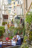 Streets of Amalfi. At Amalfi - Italy - On July 2018 - Lively street in the historical center of the town royalty free stock photos