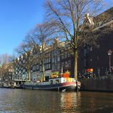 Streets in Amsterdam. Cruiseboat view in Stock Photos