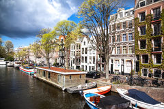 Streets of Amsterdam full of people dressed in orange celebrating King's day on April 27, 2015 of Amsterdam Stock Images