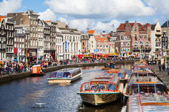 Streets of Amsterdam full of people dressed in orange celebrating King's day on April 27, 2015 of Amsterdam Royalty Free Stock Photography