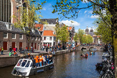 Streets of Amsterdam full of people dressed in orange celebrating King's day on April 27, 2015 of Amsterdam Stock Photos