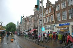 The streets of Amsterdam - one of the European capitals. Many passers-by, unique buildings. Tourist mecca. Tourism, holidays, sights, impressions for life royalty free stock photography