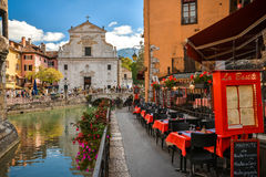 Streets of Annecy on a summer day. View of the old city of Annecy with the Palace de l`Isle and Thiou river in Annecy, France royalty free stock image