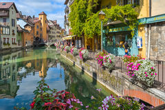 Streets of Annecy on a summer day. View of the old city of Annecy with the Palace de l`Isle and Thiou river in Annecy, France stock image