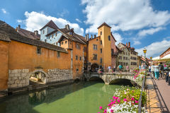 Streets of Annecy on a summer day. View of the old city of Annecy with the Palace de l`Isle and Thiou river in Annecy, France stock photo