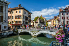 Streets of Annecy on a summer day. View of the old city of Annecy with the Palace de l`Isle and Thiou river in Annecy, France. XII century stock photos