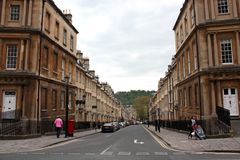 Streets of Bath. Somerset, England where almost every house is listed. Most buildings are made from the local golden-coloured (or dark yellow) Bath Stone, and Royalty Free Stock Photos