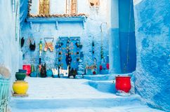 Streets of the blue city chefchaouen. With ancient doors, blue walls and green plants stock photo