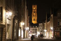 Streets of Bruges Belfry. Cobble stone street of Bruges at night Royalty Free Stock Photography
