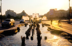 Streets of Bucharest. At dawn, Unirii area with water fountains and People's Pouse in background stock image