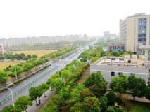 Streets and Buildings in the rain. Streets  in the light rain Stock Photo