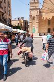 The streets of Cairo. Between the streets of Cairo you can see the play of daily life with a lord with the bike and handbags over two men on the left look Royalty Free Stock Photography