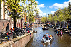 Streets and Canals of Amsterdam full of people dressed in orange celebrating King's day Stock Image