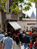 Streets of Carcassonne. Carcassonne,France,July 17th 2011:  Image of crowd of tourists in a commercial street in the fortified city of Carcassonne in Aude Royalty Free Stock Photos