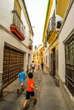 The streets of Cordoba - Spain. Cordoba/ Spain - 08/20/18 - Children running the old town area of Cordoba - Spain stock photo